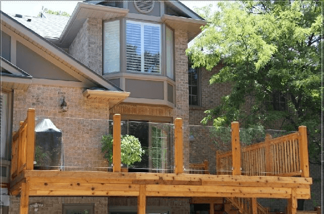 Glass railing deck design ideas for homeowners in Louisville, KY.